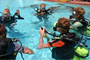Is Scuba Diving Save? Group in a pool for scuba diving training.